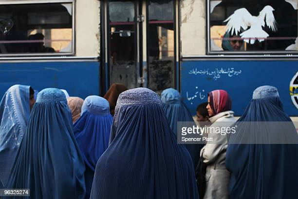 Women in burqas wait to board a bus in the old city February 1 2010 in Kabul Afghanistan Despite years of foreign involvement and the money being...