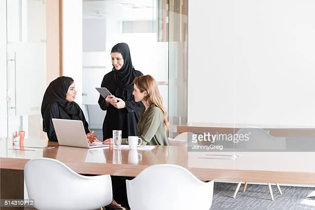 Women in business meeting in Middle East office