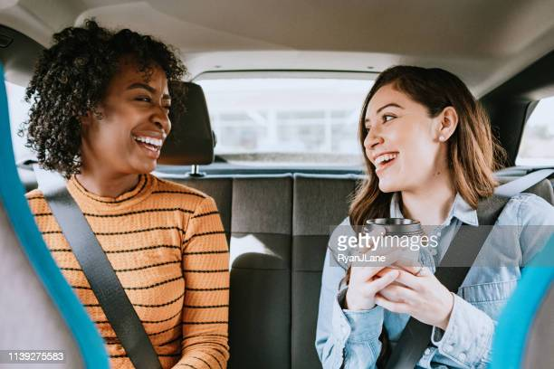 women in car rideshare in city of los angeles - car pooling stock photos and pictures