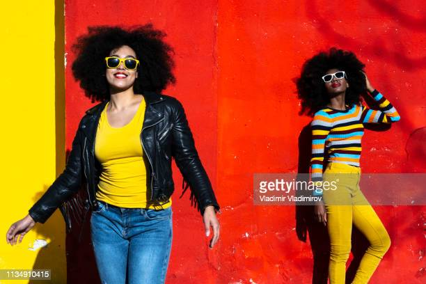 women in color - black jacket stock pictures, royalty-free photos & images