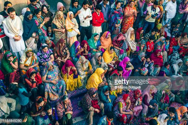 women in colorful dresses sittin in a ghat in vrindavan, india - hinduism stock pictures, royalty-free photos & images