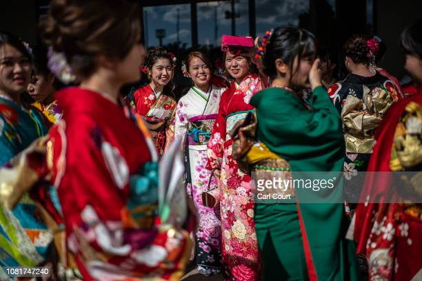 Women in colourful Okinawan kimonos arrive to attend a ceremony on Coming of Age Day on January 13, 2019 in Okinawa City, Japan. Coming of Age Day is...
