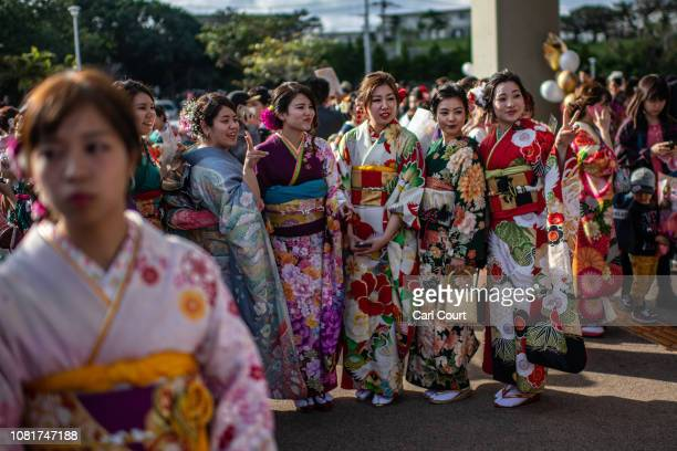 Women in colourful Okinawan kimonos pose for a photograph before attending a ceremony on Coming of Age Day on January 13 2019 in Okinawa City Japan...