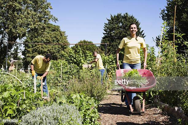 Women in Community Garden with Wheelbarrow