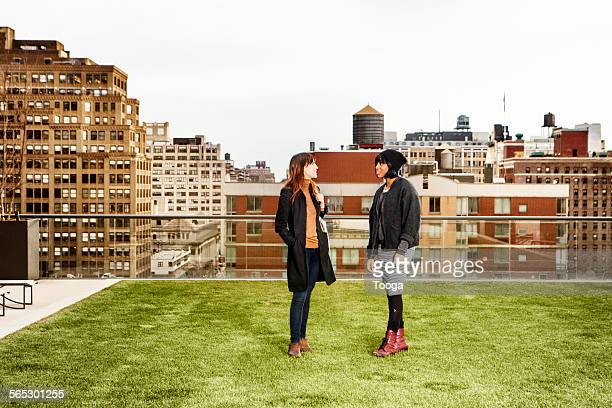 Women in conversation on rooftop