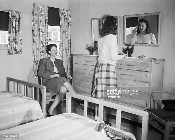 Women in converted war housing unit