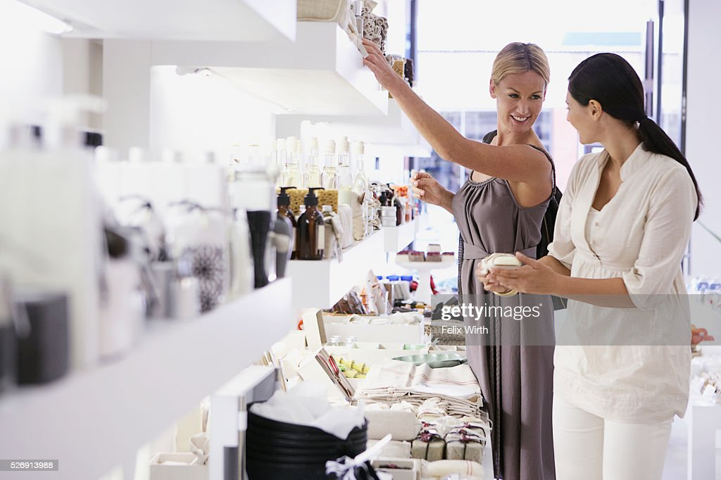 Women in cosmetics shop : Stock Photo