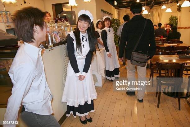 Women in costume give welcome customers at a Maid Hair Salon in the Akihabara District October 22 2005 in Tokyo Japan The Akihabara District is known...