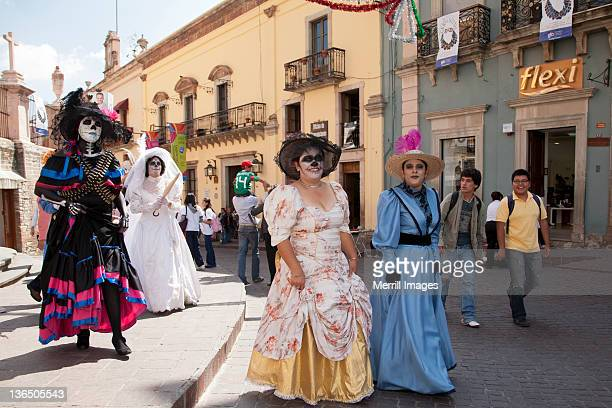 Women in costumes during Day of the Dead
