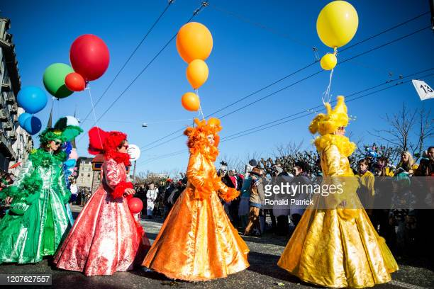 Women in costumes perform during the carnival parade on February 20, 2020 in Lucerne, Switzerland. Lucerne Carnival will be held in Lucerne February...