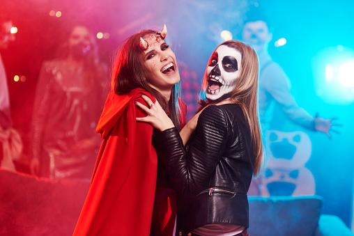 Women in creepy costumes dancing at Halloween party - gettyimageskorea