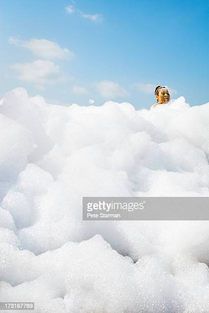women in detergent foam at mud run. - soap stock pictures, royalty-free photos & images