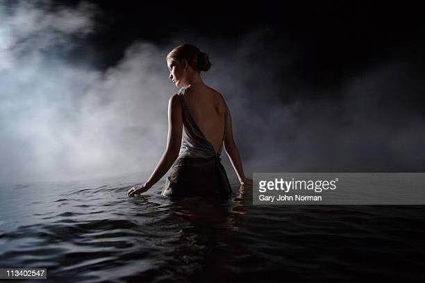women in dress appears through smoke - evening gown stock pictures, royalty-free photos & images