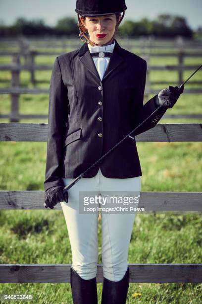women in equestrian clothing smiling at camera - riding hat stock pictures, royalty-free photos & images