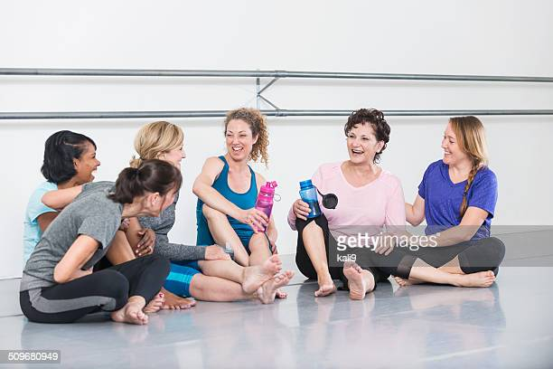 women in exercise class, taking break - barre class stock photos and pictures