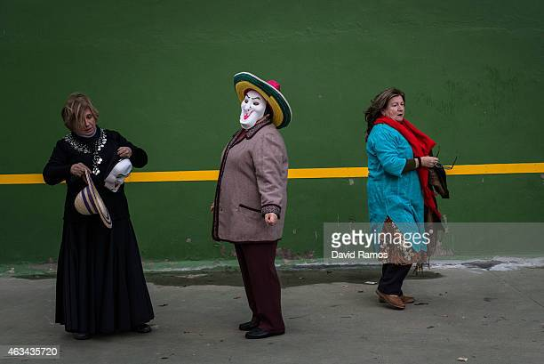 Women in fancy dress looks on as they join a carnival festival on February 14 2015 in Luzon Spain Every year Luzon hosts one of the leastknown...