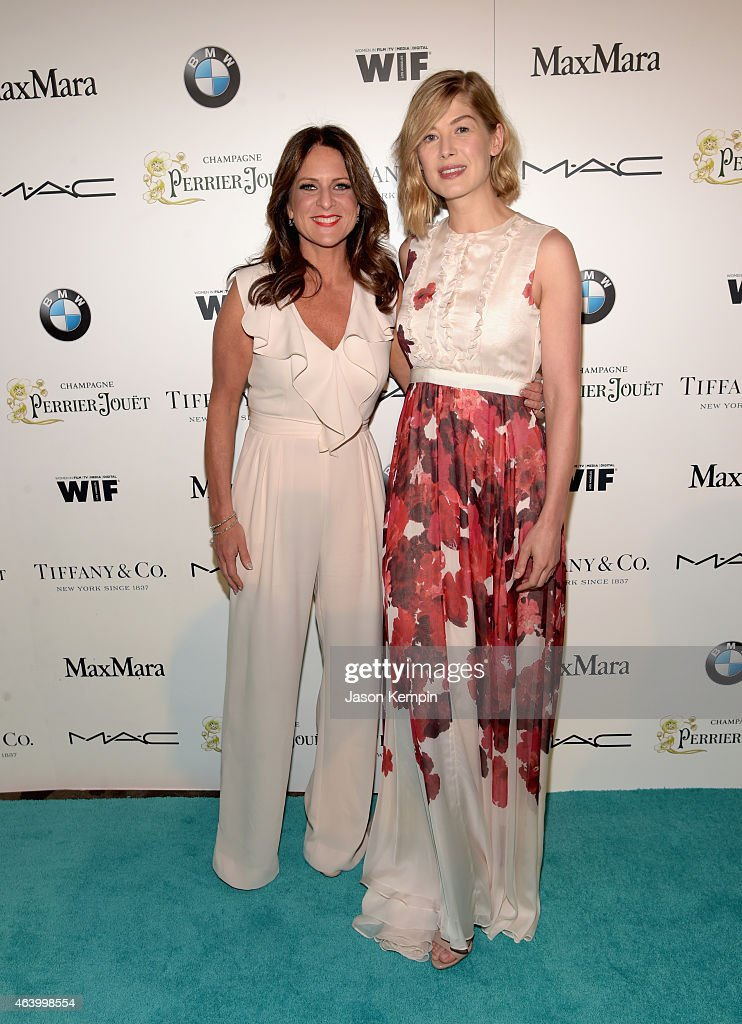 Women In Film President Cathy Schulman (L) and actress Rosamund Pike attend Women In Film Pre-Oscar Cocktail Party presented by MaxMara, BMW, Tiffany & Co., MAC Cosmetics and Perrier-Jouet at Hyde Sunset Kitchen + Cocktails on February 20, 2015 in Los Angeles, California.