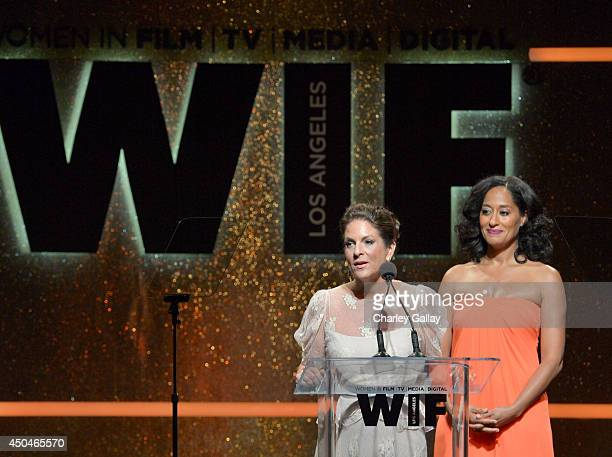 Women In Film President Cathy Schulman and host Tracee Ellis Ross speak onstage at Women In Film 2014 Crystal Lucy Awards presented by MaxMara BMW...