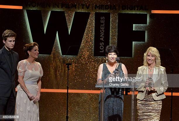 Women In Film President Cathy Schulman looks on as honorees Bonnie Spence and Judith Parker Harris accept the Founder's Award onstage at Women In...