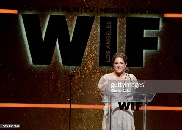 Women In Film President Cathy Schulman speaks onstage at Women In Film 2014 Crystal Lucy Awards presented by MaxMara BMW PerrierJouet and South Coast...