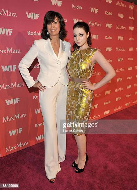Women In Film president Jane Fleming and actress Michelle Trachtenberg arrive at the Women In Film 2009 Crystal Lucy Awards at the Hyatt Regency...