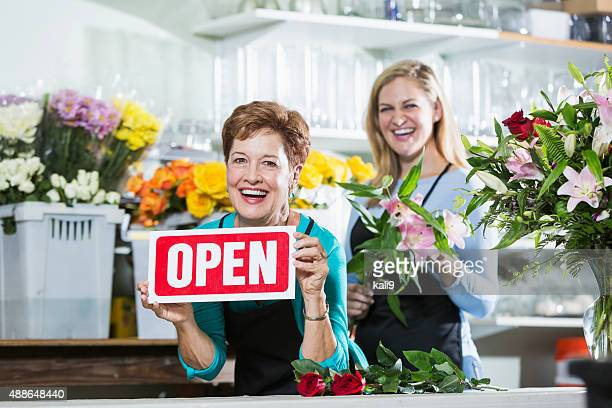 women in flower shop open for business - kali rose stock pictures, royalty-free photos & images