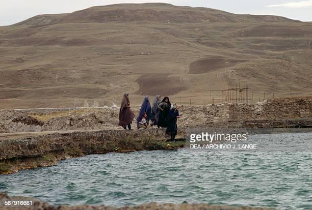 Women in front of a river near a Kurdish village Iranian Azerbaijan Iran