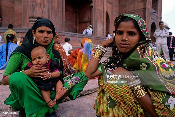 Women in front of the MasjidiJahan Numa know as Jama Masjid which is the principal mosque of Old Delhi achieved in 1656 AD
