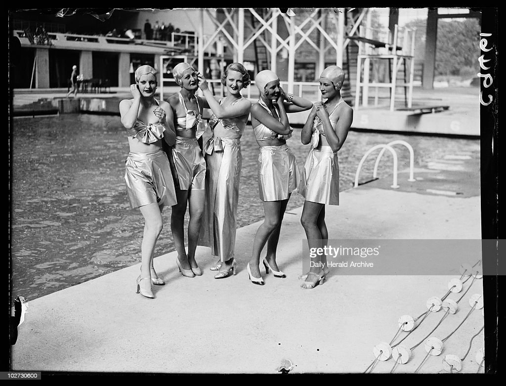 Women in futuristic swimwear, 1934. A photograph of a group of women dressed in futuristic swimwear by a pool, taken by Edward Malindine for the Daily Herald newspaper on 27 July, 1934. The occasion is the opening of the Empire Pool in Wembley. The venue later became an ice rink, hosting various sporting events. By the late 1960s it was increasingly used as a concert venue - renamed Wembley Arena in the late 1970s. This photograph has been selected from the Daily Herald Archive, a collection of over three million photographs. The archive holds work of international, national and local importance by both staff and agency photographers.