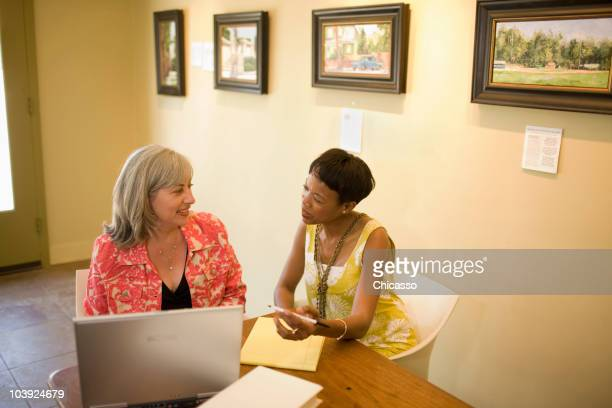 women in gallery using laptop - museum curator stock pictures, royalty-free photos & images