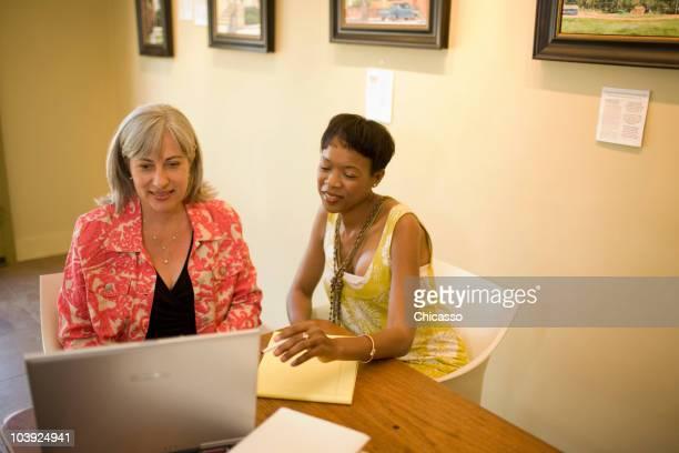 Women in gallery using laptop