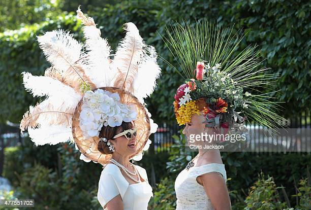 Women in hats chat as they arrive for Ladies Day on day 3 of Royal Ascot at Ascot Racecourse on June 18, 2015 in Ascot, England.