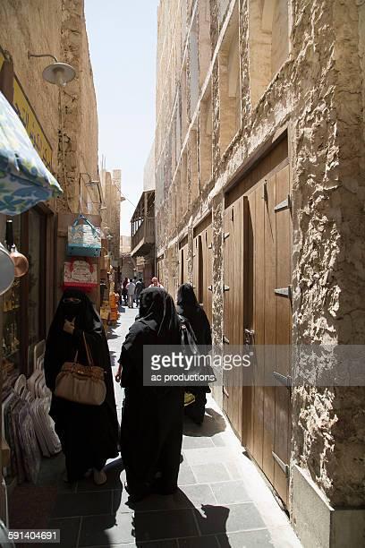 women in hijab walking on doha sidewalk, doha, qatar - hot arab women stock photos and pictures