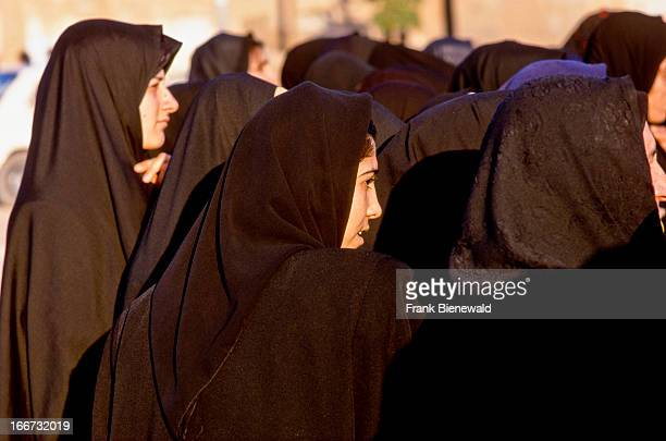 Women in Iran are forced by law to wear the Tschaddor the black cape which covers the women almost completely