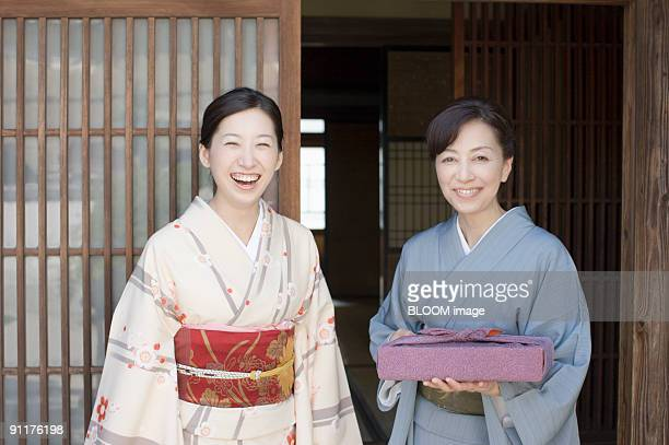 Women in kimono, smiling