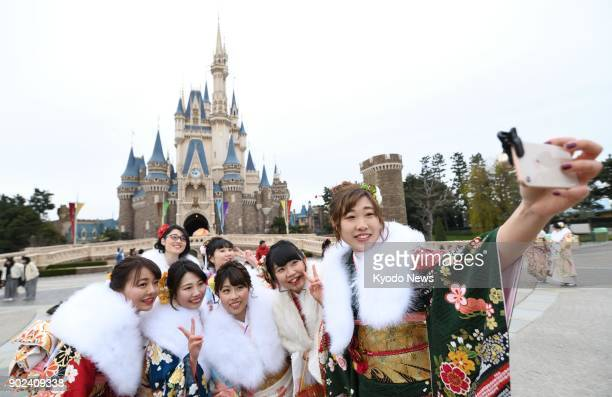 Women in kimono take a selfie at Tokyo Disneyland during a ceremony marking their coming of age on Jan 8 2018 ==Kyodo