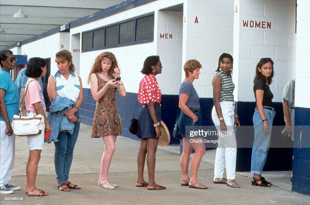 Women in line for the restroom : Stock Photo