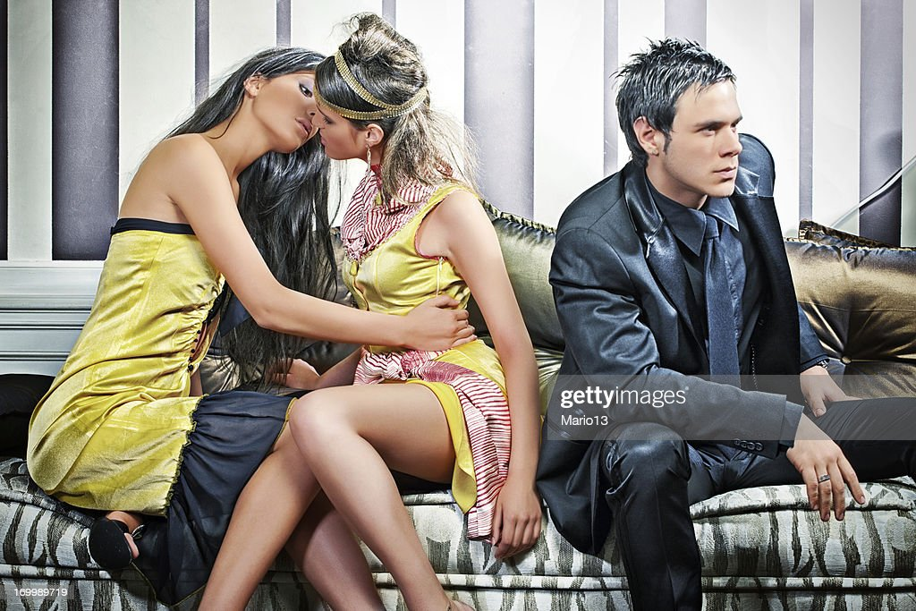 Women in love next to jelous man : Stock Photo