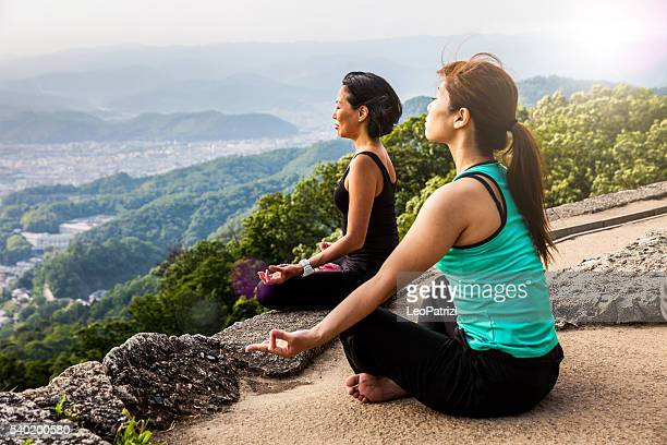 Women in meditation, doing Yoga in Japan