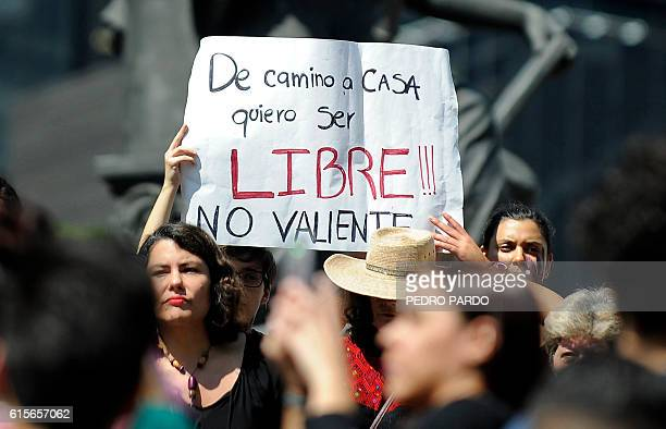 Women in Mexico City hold a poster reading On the Way Back Home I Want to be Free Not Brave as they take part on October 19 2016 in a march in...
