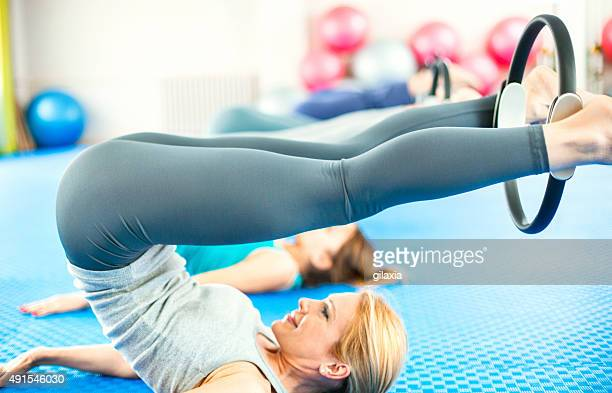 women in pilates class. - women wearing spandex stock photos and pictures