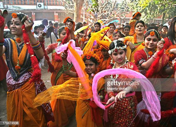 Women in red and yellow saris to symbolise the new season gathering to celebrate the first day of Basanto the spring season at the Institute of Fine...