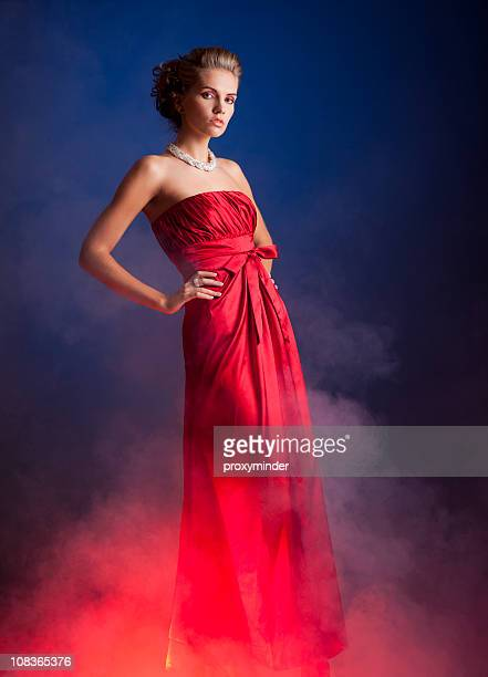 women in red dress - red dress stock photos and pictures