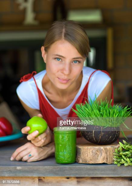 women in red - wheatgrass stock photos and pictures