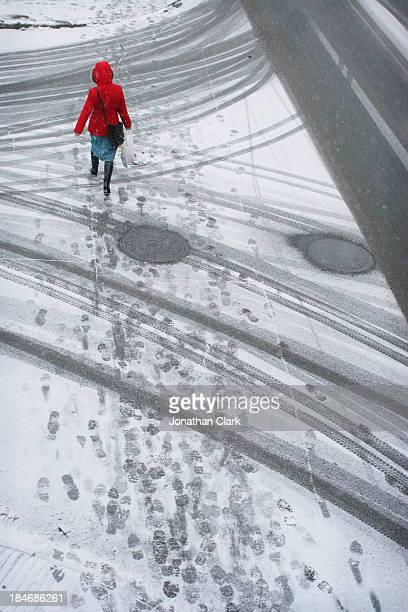 Women in red walking across the road leaving print