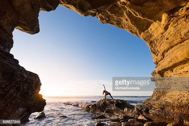 Women In Salutation Pose In An Ocean Cave