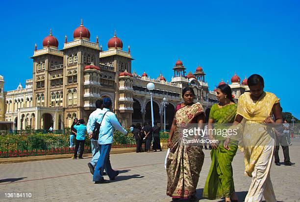 Women in sarees visiting the Mysore Maharaja Palace built in the indosaracenic style at December 18 2011 in Mysore Karnataka India The Mysore Palace...