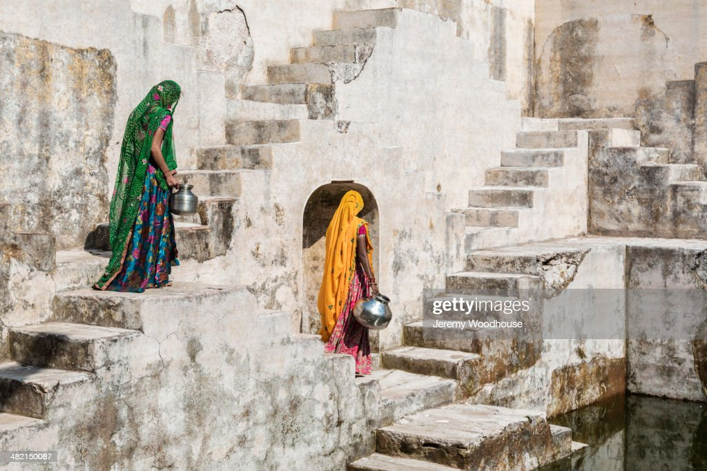 Women in saris carrying water at step well, Jaipur, Rajasthan, India : Stock Photo