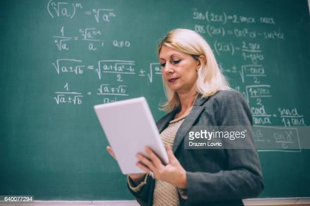 Women in science  - math professor using digital tablet