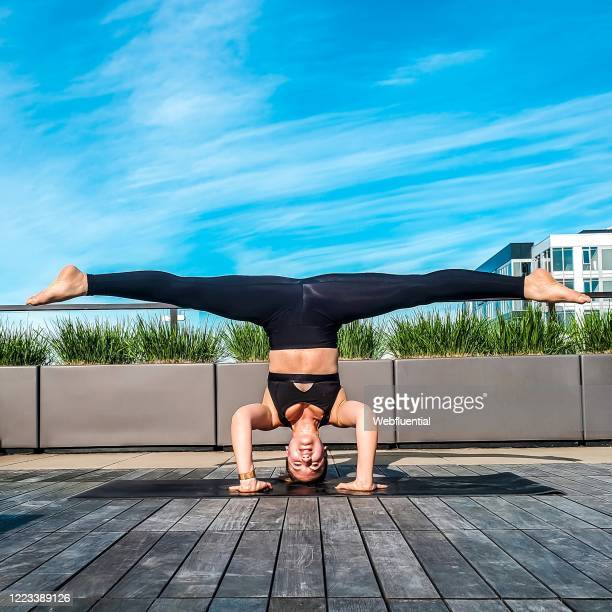 women in self-isolation doing yoga at home - webfluential stock pictures, royalty-free photos & images